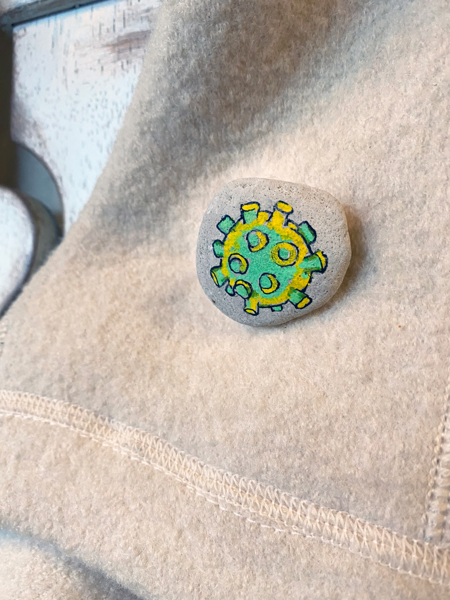 This is a little painting I made into a pin... it's a coronavirus.